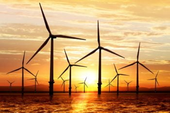 Offshore wind farm in sunset