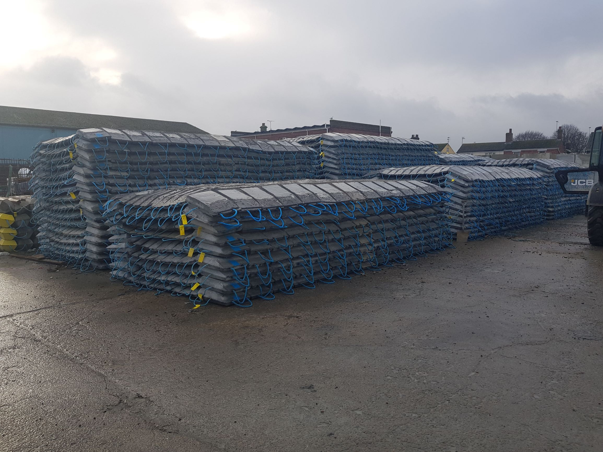 Flood defence scour protection mattresses constructed with high density concrete for stabilising riverbeds