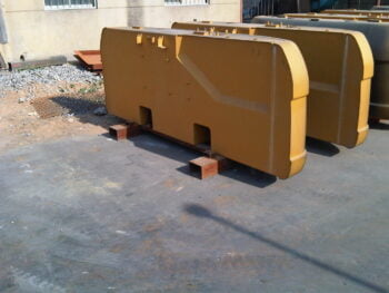 Counterweights for heavy machinery